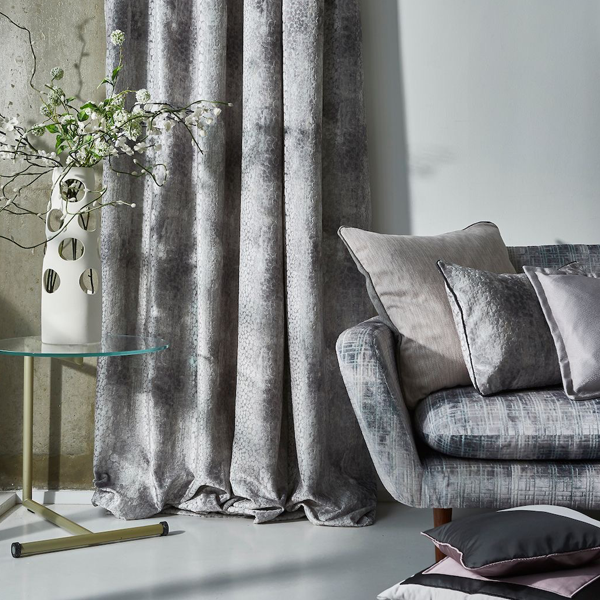 silvery curtains and matching sofa
