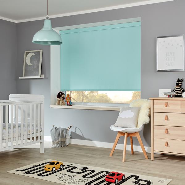 blue roller blind in nursery room